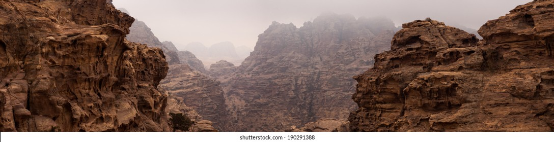 Mountain Cliffs Panorama in The Jordan Desert of Petra, with a cloudy scenery