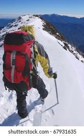 mountain climber on snowy summit