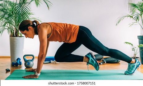 Mountain climbers, Woman Exercising Indoors, HIIT or high intensity interval training at home