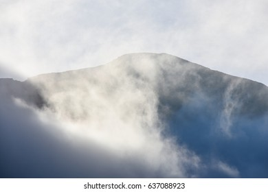 Mountain with clouds and haze