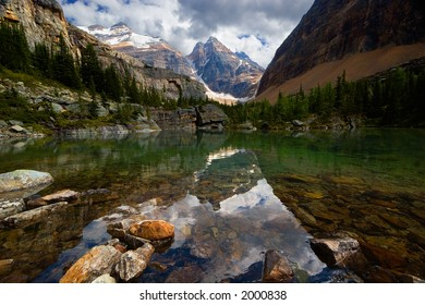 A mountain and clouds reflecting in a small lake. Lake Victoria, Yoho National Park, BC, Canada