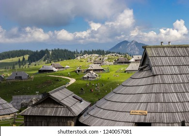 Mountain cottage hut or house on idyllic hill Velika Planina. Eco farming.Travel destination for family hiking. Kamnik Alps, Slovenia.