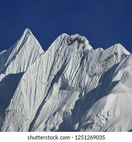 Mountain covered by glacier. Sharpe ridge. Scene in the Everest National Park Nepal.