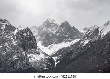 Mountain covered with snow in black and white.