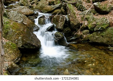 Mountain creek flowing over stones. Long exposure photo of stream. Flowing water, motion blur. Waterfall or cascade on small river in deep forest. Divoky dul, Jeseniky mountains, Czech Republic. - Shutterstock ID 1721254381