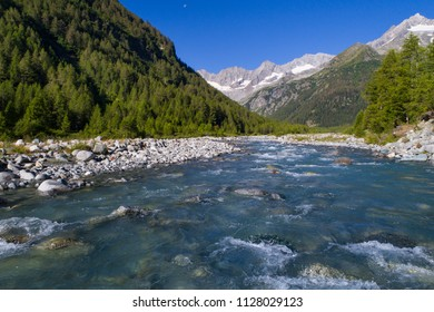 Mountain creek, valley with forest and river