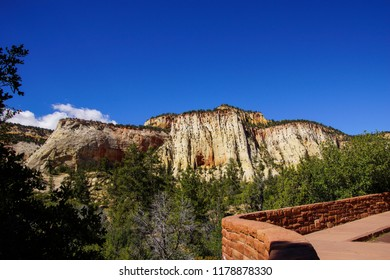 Mountain with cross current layers of colored sandstone, created from fossilized dunes and shifting winds over millions of years, Zion National Park, Utah