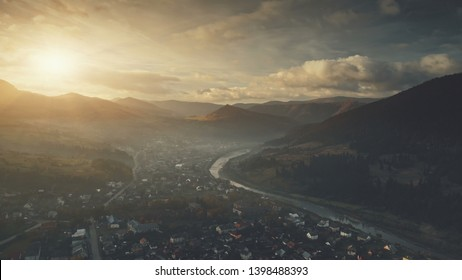 Mountain Dawn Sunset Suburban Cottage Town Aerial View. Beautiful Soft Light Highland Settlement Overview. Nature Landscape. Carpathians Village, Ukraine. Cinematic Drone Flight