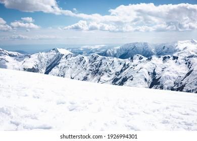 Mountain descent and mountains. Clouds in the sky. Ski destination in Georgia. Gudauri.