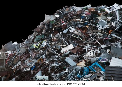 Mountain of discarded trash on a black background
