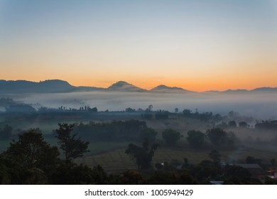 Mountain and fog at morning sunrise time.