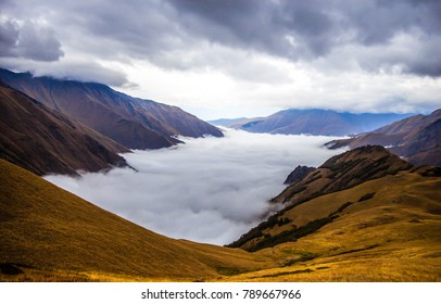 Mountain fog sky clouds landscape. Mountain water fog valley. Fog in mountain valley view