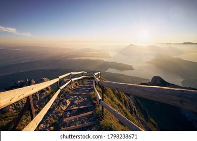 Mountain footpath to Mount Pilatus against Lake Lucerne. Landscape at beautiful sunrise, Switzerland.