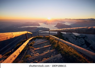Mountain footpath to Mount Pilatus against Lake Lucerne. Landscape at beautiful sunrise, Switzerland.