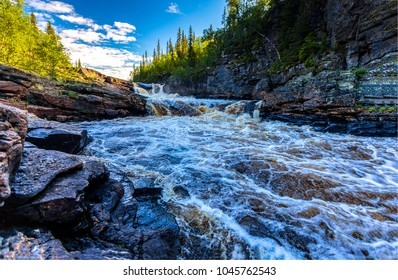Mountain forest river landscape. Wild river waterfall stream