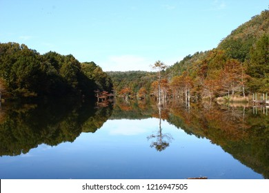 Mountain Fork River at Beavers Bend State Park in Broken Bow Oklahoma.  Empty space for text, quote, or saying on sky background.