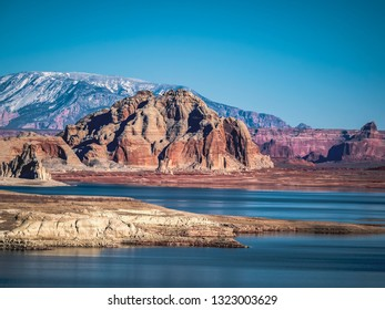 Mountain formations and red rock layers and sediments on the banks of Powell Lake, near Page, Arizona, United States in Lone Rock National Park.