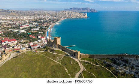Mountain fortress (Genoese Fortress). Genoese Fortress is located in Sudak, Coast of the Crimea peninsula, rocky mountains, aerial view of the sea resort Sudak