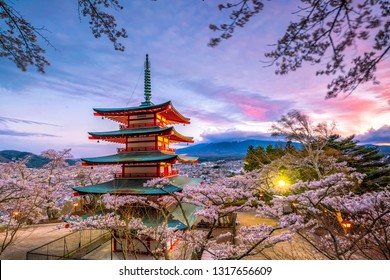 Mountain Fuji and Chureito red pagoda with cherry blossom sakura at sunset