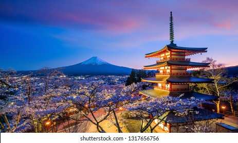 Mountain Fuji and Chureito red pagoda with cherry blossom sakura at sunset