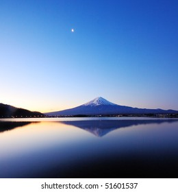 the mountain Fuji at dawn with peaceful lake reflection