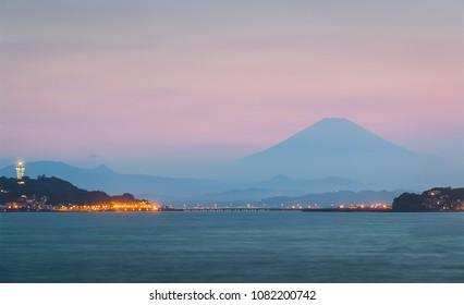 Mountain Fuji and Enoshima Island at sunset in spring season