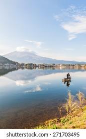 Mountain Fuji with fisherman view of kawaguchiko lake, Japan.