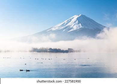 Mountain Fuji and Kawaguchiko lake with morning mist in autumn season
