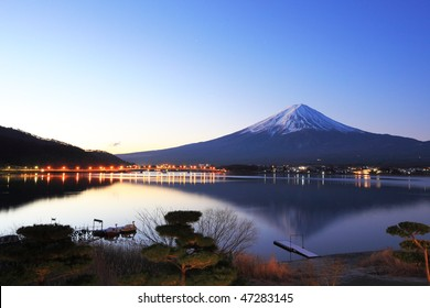 Mountain Fuji and reflections on lake Kawaguchi at dawn