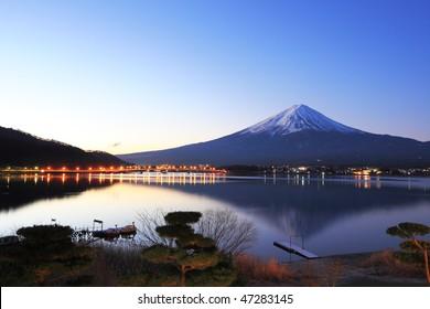 Mountain Fuji and reflections on lake Kawaguchi at dawn
