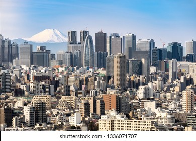 Mountain Fuji with Tokyo skylines and skyscrapers buildings in Shinjuku ward in Tokyo.