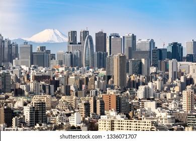 Mountain Fuji with Tokyo skylines and skyscrapers buildings in Shinjuku ward in Tokyo.