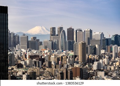 Mountain Fuji with Tokyo skylines and skyscrapers buildings in Shinjuku ward in Tokyo. Taken from Tokyo Bunkyo civic center observatory sky desk.