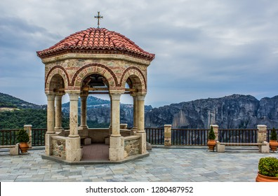 mountain gazebo medieval European stone building in ancient orthodox religion yard complex with view on beautiful picturesque highland background landscape in cloudy weather, travel pilgrim concept