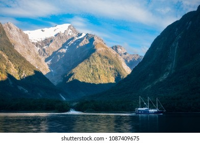 Mountain and glacier view from the Cruise Boat at Harrison Cove in Milford Sound, Fiordland National Park, New Zealand. The photo is illustrating also the melting of the glacier taking place.