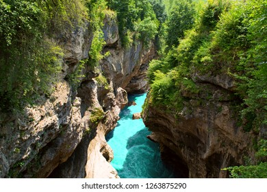 Mountain gorge & river. Beautiful landscape featuring mountain river sandwiched between towering cliffs gorge. Amazing scenic vivid turquoise river stream rapids, running through mountain gorge forest