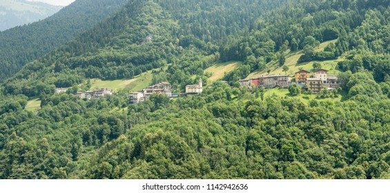 mountain green landscape with small village, shot in bright summer light at Azzone di Scalve, Bergamo, Orobie, Lombardy, Italy