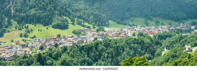 mountain green landscape with touristic village, shot in bright summer light at Colere, Bergamo, Orobie, Lombardy, Italy