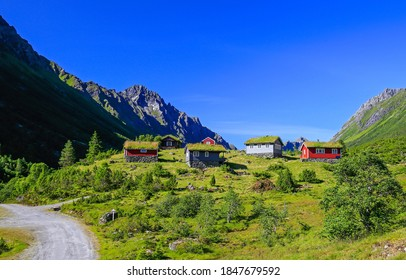 Mountain green valley cabins landscape. Mountain cabins view. Mountain cabins landscape. Mountain cabins