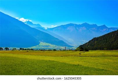 Mountain green valley landscape. Green valley in mountains. Mountain green valley view. Mountain valley landscape