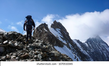 mountain guide on his way to the summit of Eiger mountain in the Swiss Alps