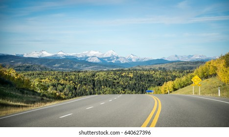Mountain highway road with Rocky Mountains in the background, Alberta, Canada
