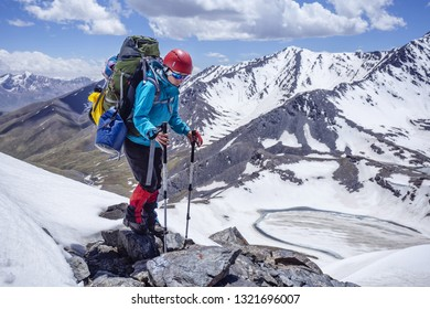 Mountain hike in Kyrgyzstan, a girl climber in the mountains