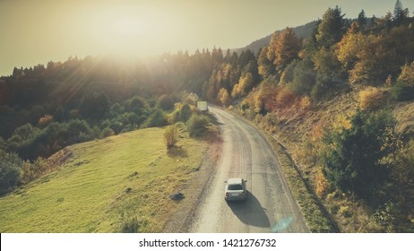 Mountain Hill Country Road Car Drive Aerial View. Roadside Automobile Highland Scenery Landscape Overview. Dense Green Forest Unpolluted Natural Environment Concept. Drone Flight