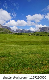 Mountain hut amid the green alpine meadows of the  Dolomites Alps, Italy