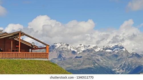 Mountain hut with beautiful view over snowy mountains, Plan de Corones (Kronplatz), Dolomite Alps, South Tyrol, Italy.