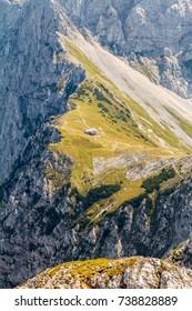 Mountain hut on a mountain pass, Slovenian Alps