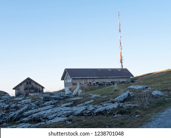 a mountain hut on a rock in Switzerland