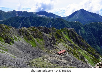 A mountain hut on Yarigatake and a ridge line of the Japanese Alps, Nagano, Japan.