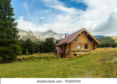Mountain Hut. Solitary Cabin with a mountain range in the background